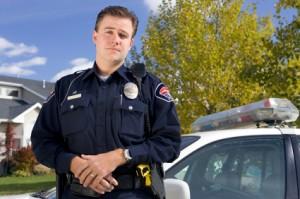 policeofficerinfrontofcar
